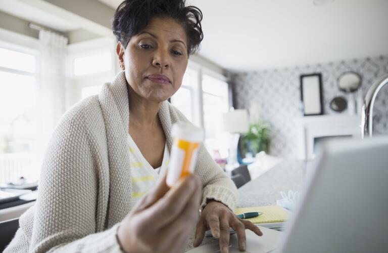 prescription-medication-woman-with-pill-bottle
