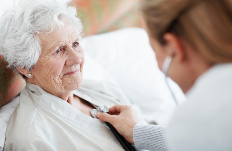 doctor examining elderly patient