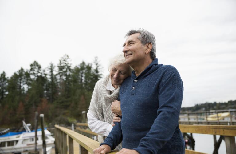 couple-embracing-on-dock
