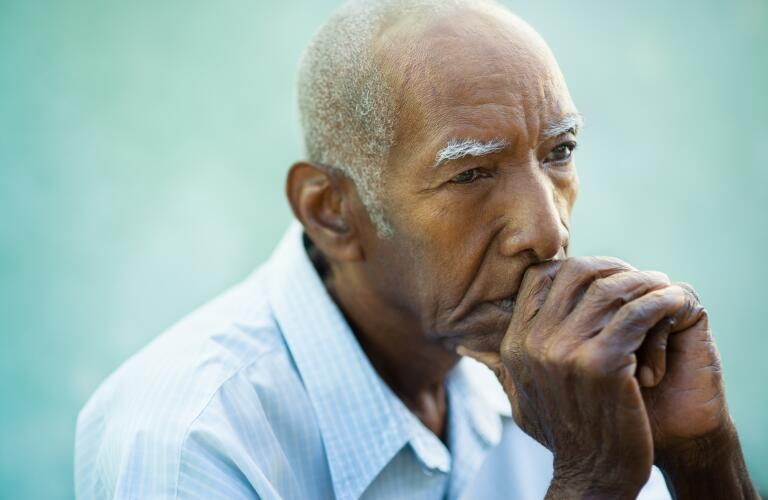 serious senior male in comtemplation