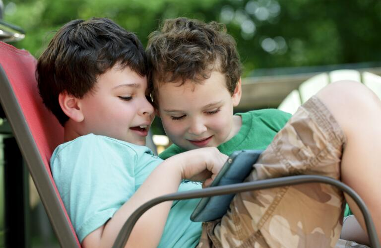 two-boys-using-tablet