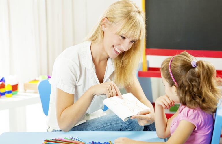 Speech Therapist Talking with Child