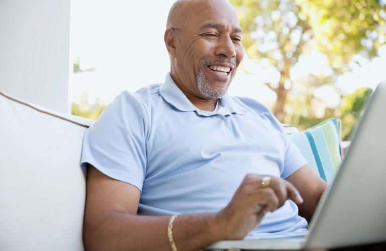 senior-man-on-laptop-outdoors