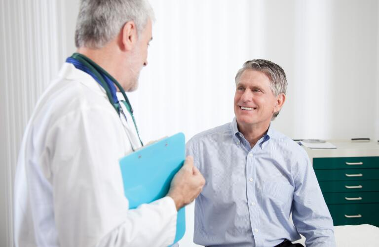A-doctor-talks-to-a-male-patient
