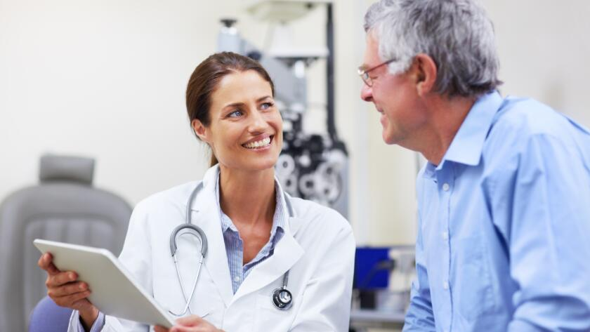 Doctor showing patient information