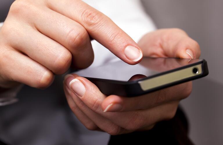 woman scrolling through phone