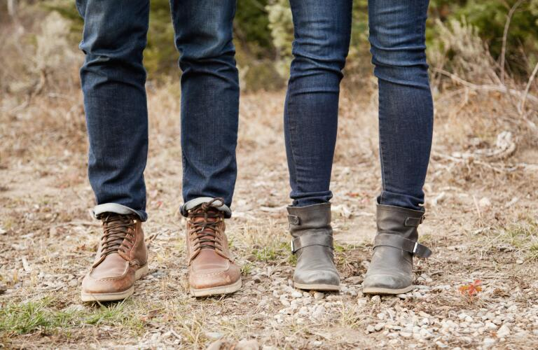 view-of-man-and-womans-legs-standing-outside
