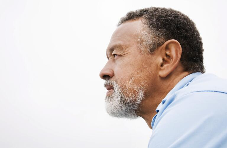 thoughtful African American man gazing into distance