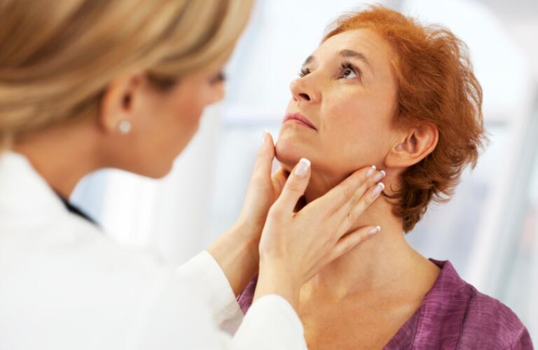 Female doctor examining her patient