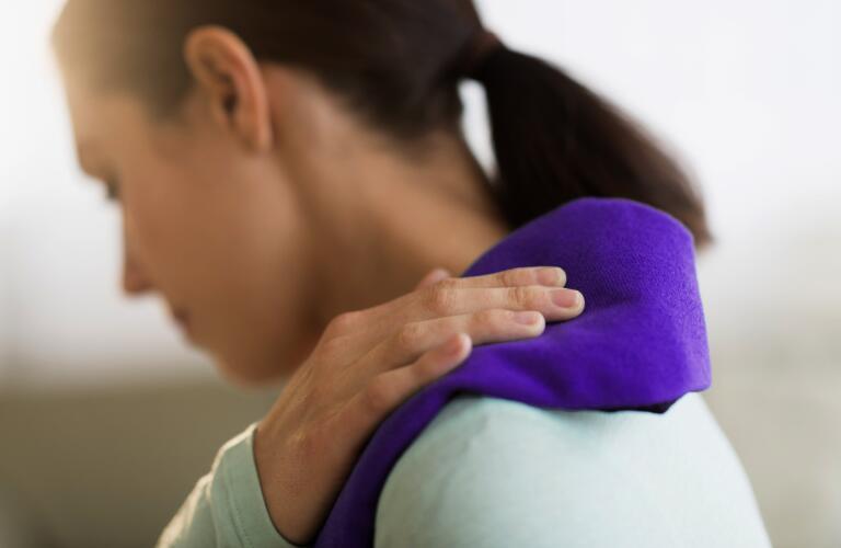 woman icing shoulder