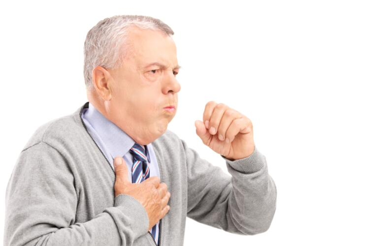 Mature gentleman coughing because of pulmonary disease