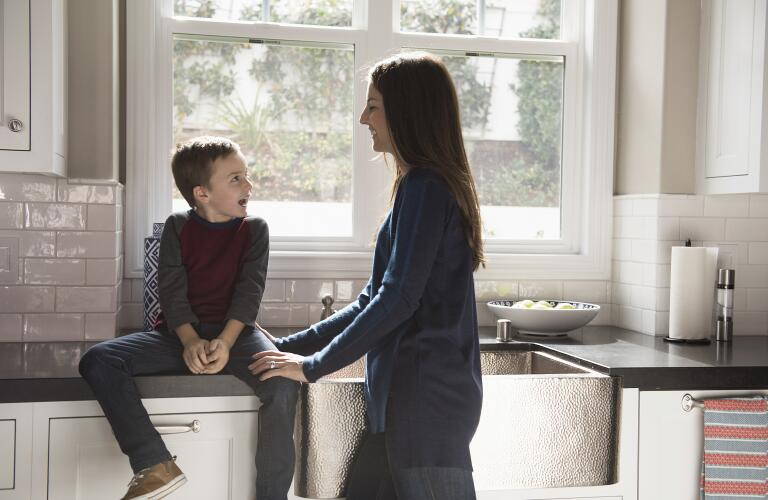 mother-talking-with-son-in-kitchen