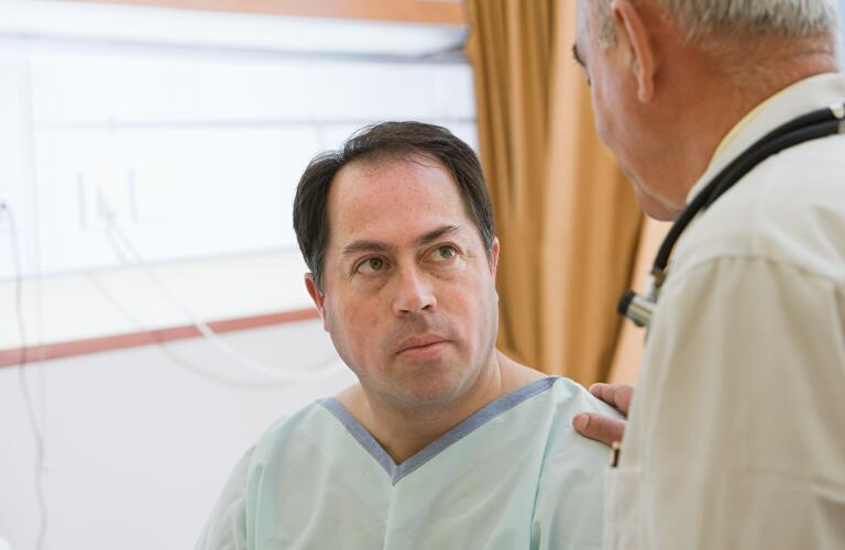 male patient receiving news from doctor