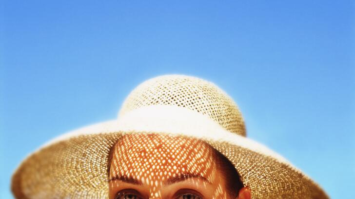 Image of woman wearing a sun hat
