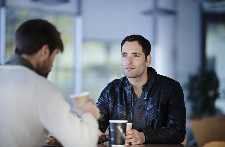 man-having-coffee-with-friend
