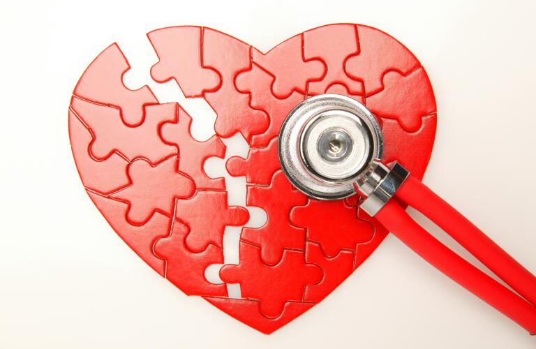 Heart puzzle broke in half with stethoscope