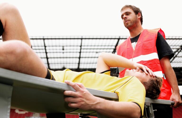 athlete on stretcher