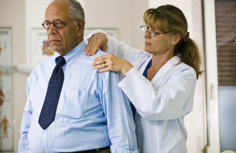 doctor-examining-patients-shoulder