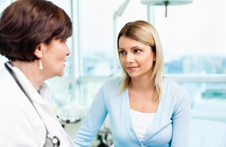 young adult talking to doctor