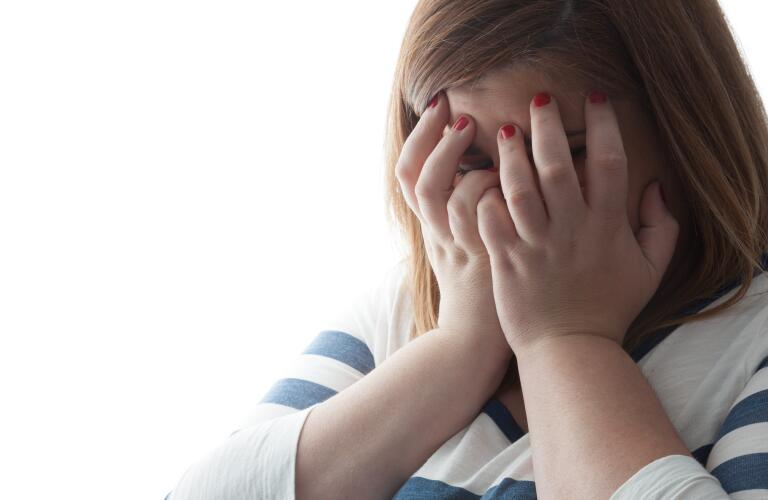 depressed-woman-with-hands-over-face