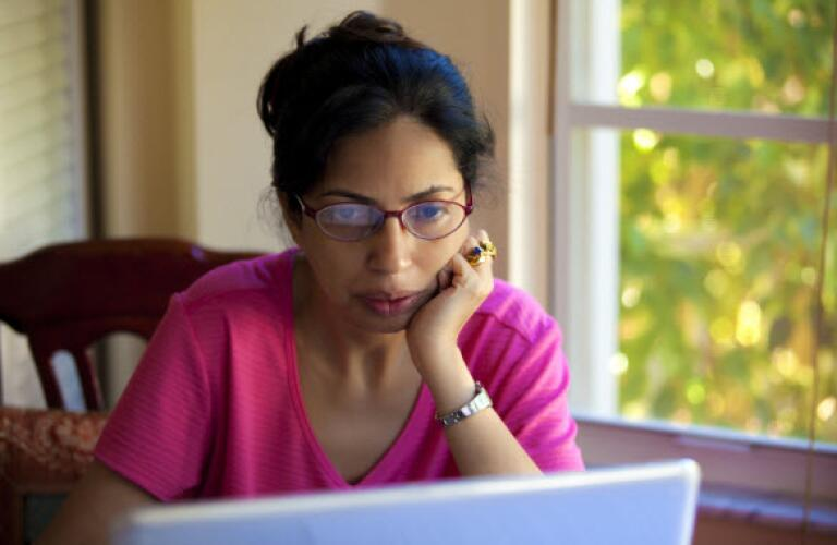serious woman on laptop