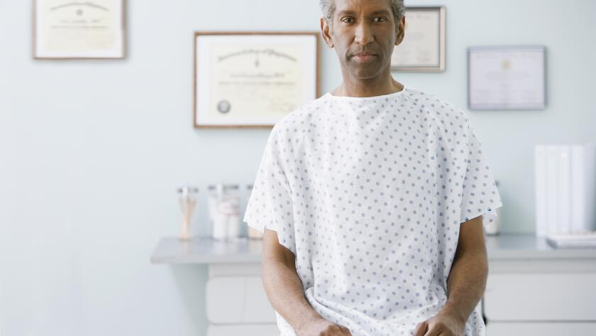 Man in hospital gown