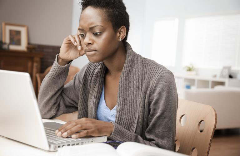 African American woman on computer at home
