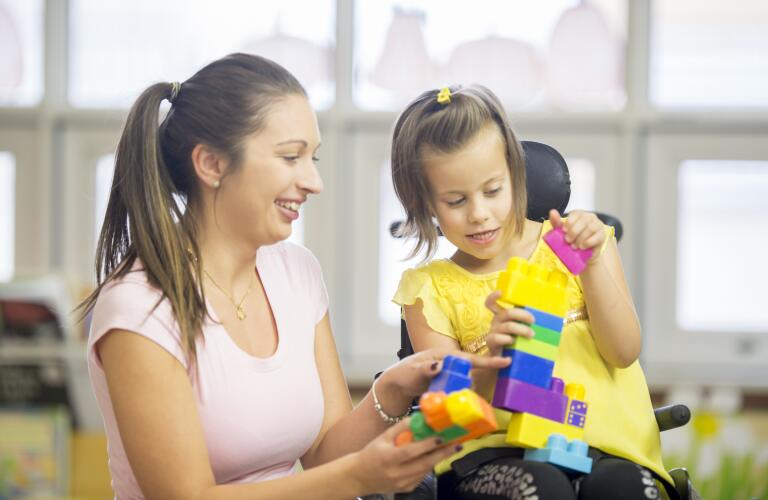 therapist-playing-with-girl-with-cerebral-palsy
