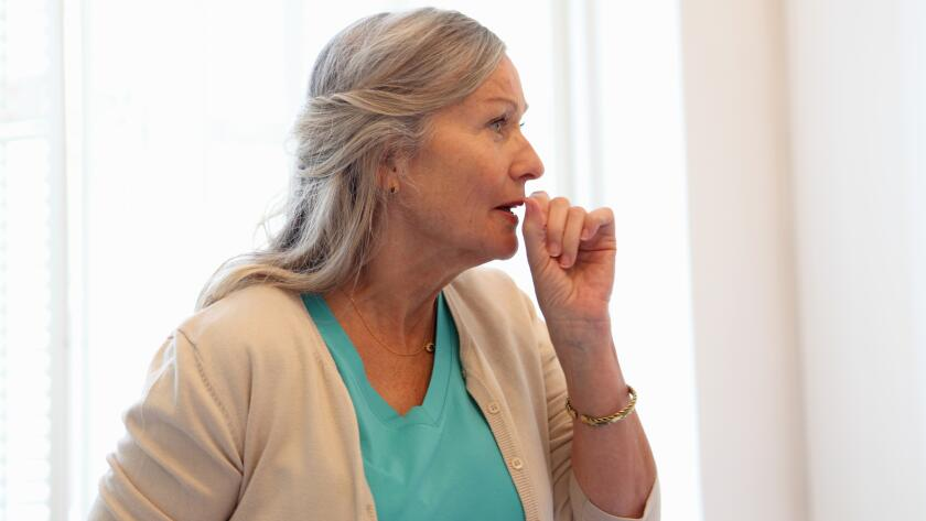 older woman coughing