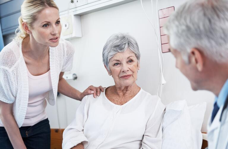 mother and daughter talking to doctor