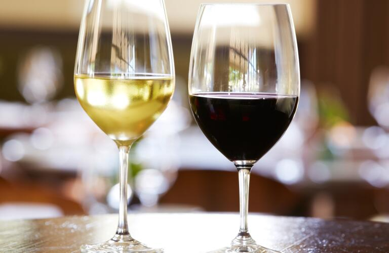 glasses of red and white wine on table