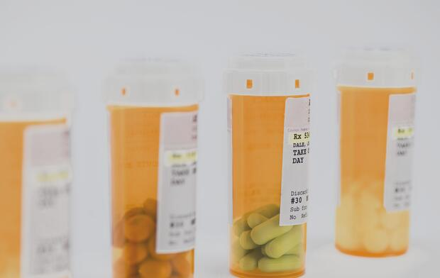 row-of-prescription-pill-bottles
