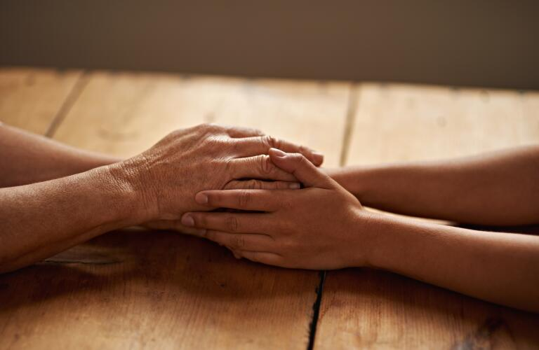 hands-holding-on-table