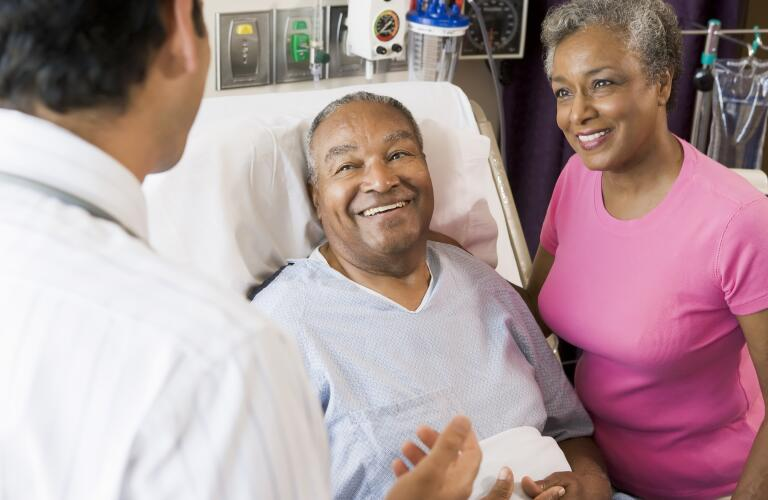 Mature couple with doctor