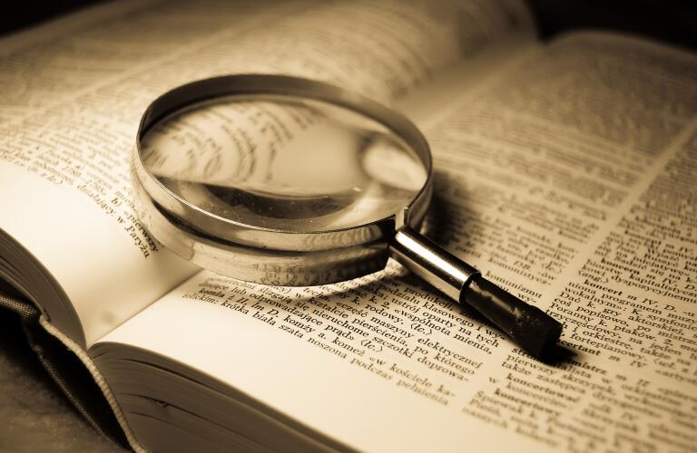 magnifying-glass-on-open-book