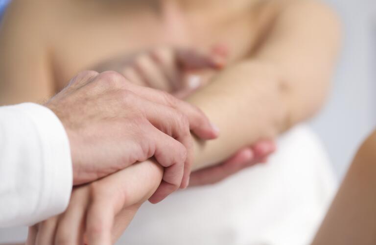 doctor-examining-patients-arm