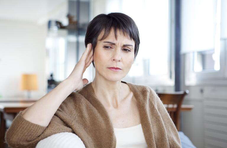 middle aged woman with tinnitus