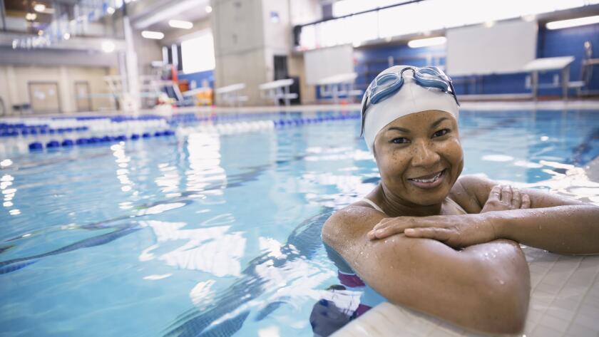 smiling-woman-in-swimming-pool