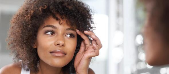 Woman looking at eyebrows