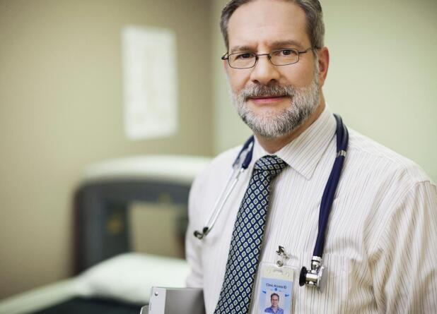 doctor-with-stethoscope-looking-at-camera