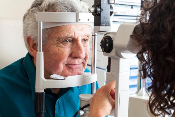 Senior man getting eyes checked