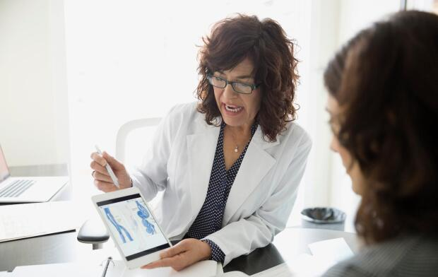 female physician explaining results to patient