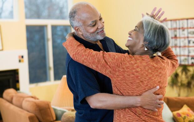 senior-couple-dancing-in-living-room