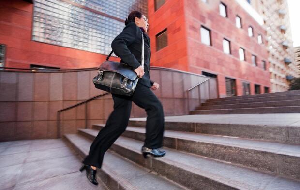 Woman walking stairs