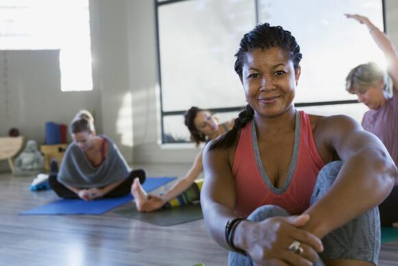 smiling woman in yoga class