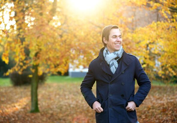 man-smiling-outdoors-on-autumn-day