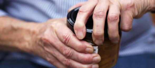 elderly hands opening jar