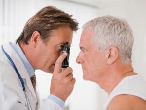 580e85e24bc Doctor examining patients eyes