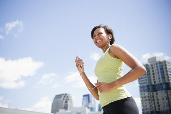 Black woman exercising and listening to mp3 player