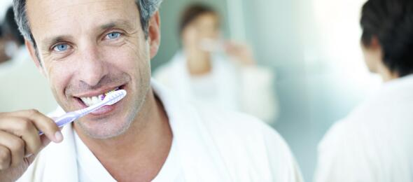 guy brushing teeth